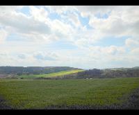 Prodej pozemku o výměře 6 204 m2 určený k výstavbě rodinných domů, Hudlice, okr. Beroun